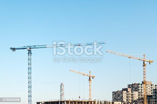 istock Multistorey multistorey buildings construction site with tower cranes 578093008