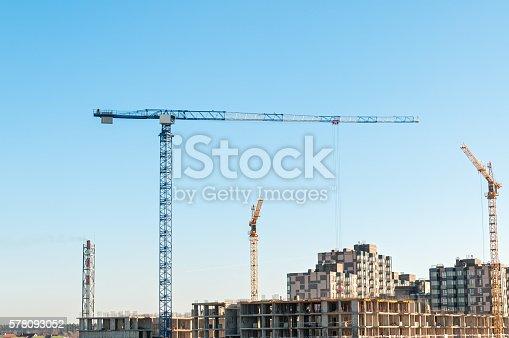 istock Multistorey multistorey buildings construction site with tower cranes 578093052