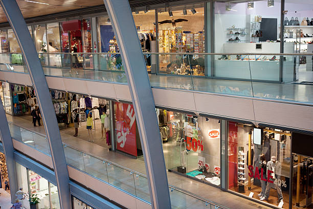 multistorey shopping center - shopping mall stock photos and pictures