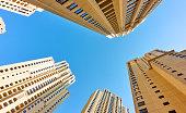 Multistory apartment buildings against the blue sky, Dubai, UAE