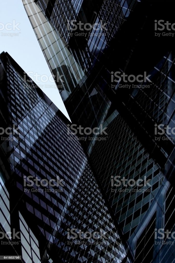 Multistory office buildings. Reworked tilt photo of business cityscape fragment with skyscrapers. stock photo
