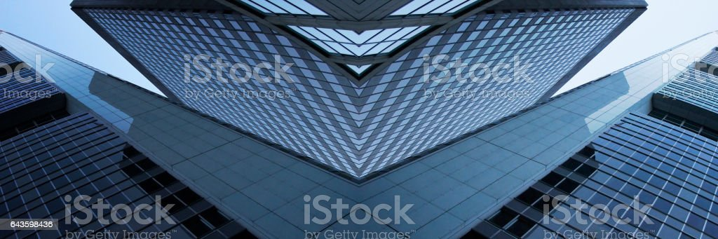 Multistory office buildings / skyscrapers with structural glazing. Modern urban architecture. Reworked tilt photo of business cityscape fragment. stock photo