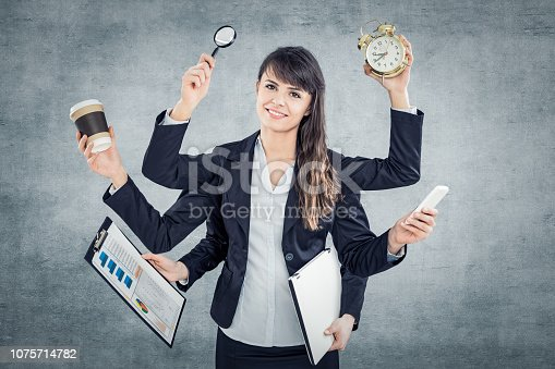 istock Multitask business woman with many hands. 1075714782