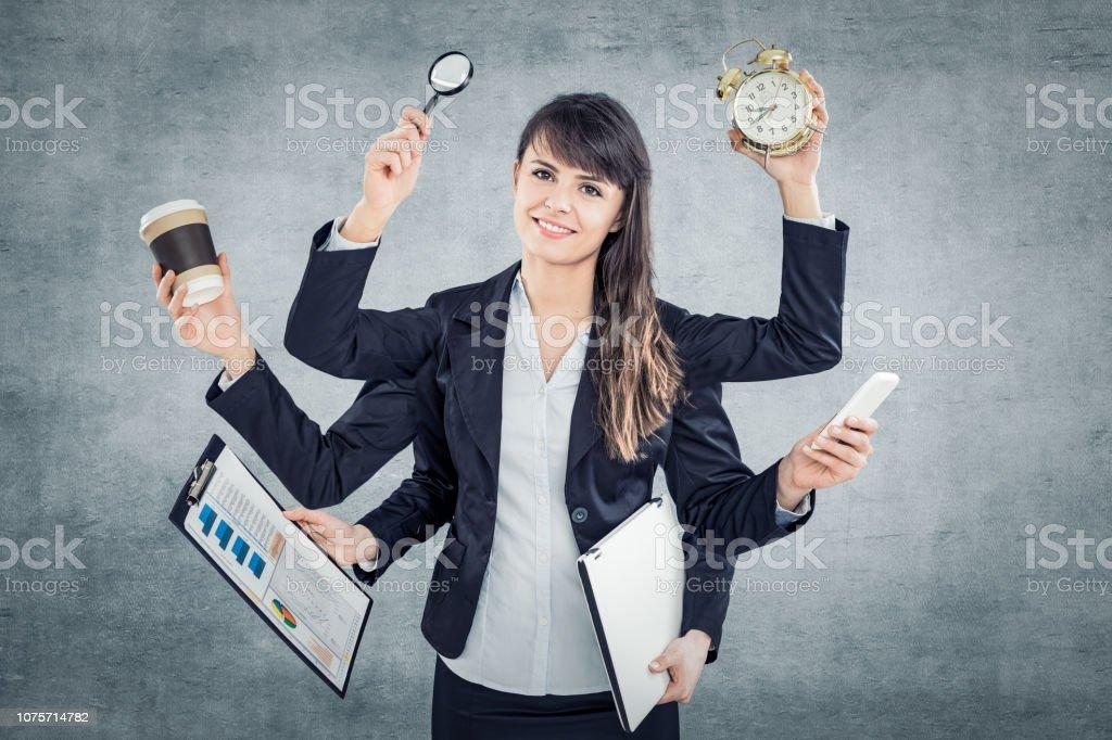 Multitasking, Business-Frau mit vielen Händen. – Foto