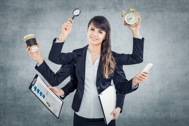 Multitask business woman with many hands. stock photo
