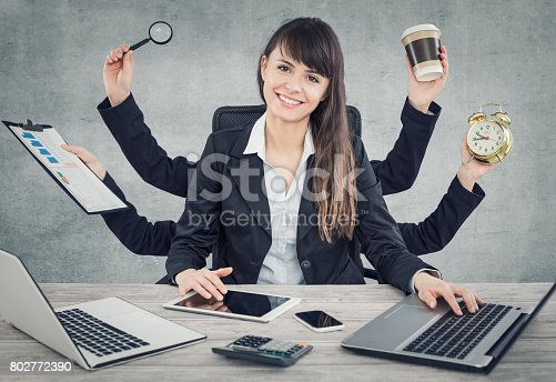 istock Multitask business woman with many hands. 802772390