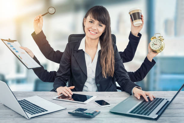 multitask business woman with many hands. - efficiency stock photos and pictures