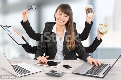 istock Multitask business woman with many hands. 843649260