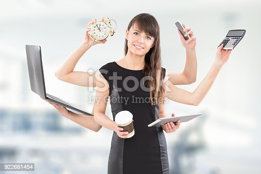 istock Multitask business woman with many hands. 922661454