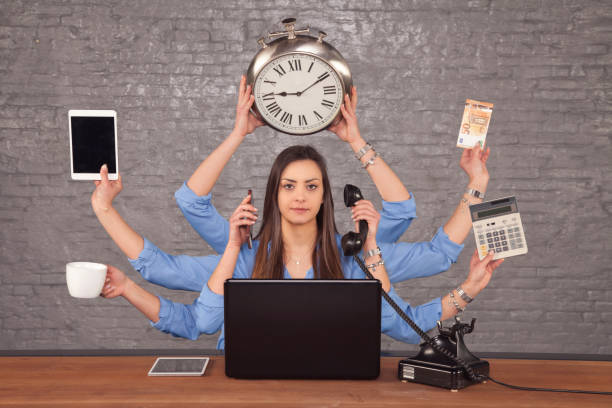 multitask businesswoman sat at the desk in the office, concept of well organized work multitask businesswoman sat at the desk in the office, concept of well organized work multi tasking stock pictures, royalty-free photos & images