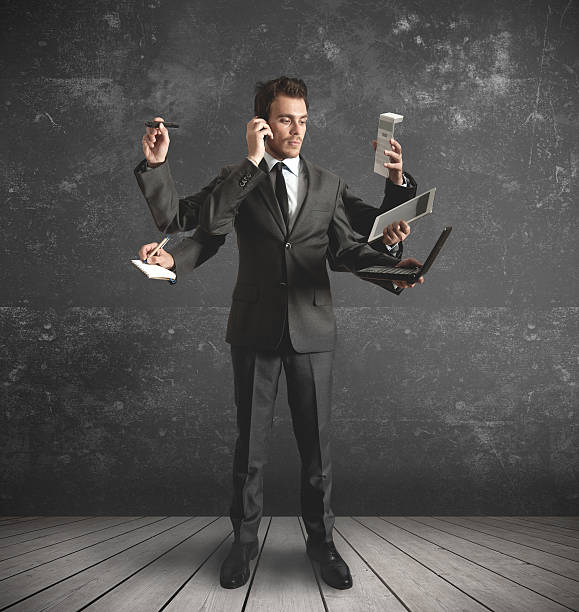 Multitasking businessman businessman stressed by too many tasks multi tasking stock pictures, royalty-free photos & images