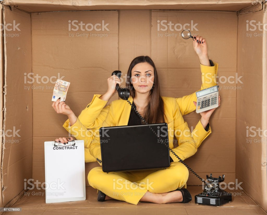 multitasking businesswoman siting in the box office stock photo