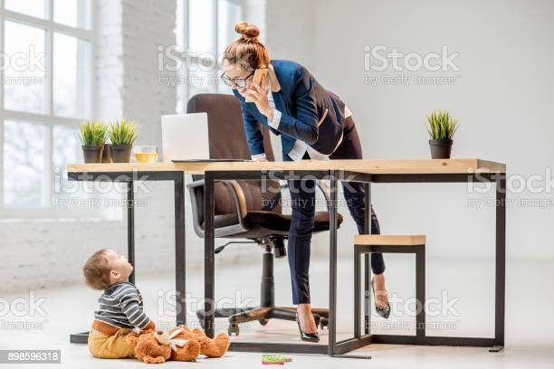 Multitasking businesswoman with her son at the office picture id898596318?b=1&k=6&m=898596318&s=612x612&h=hq6js3wni7 jvl hol1s7s do3f7yn1hz1sqeicf u8=