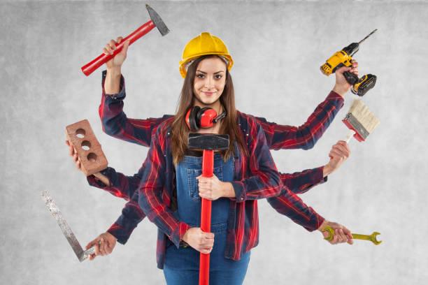 multitasking female worker, many hands stock photo