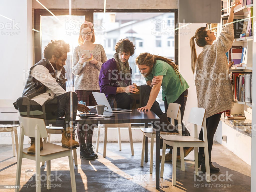 Multi-tasking group of creative people working in the office. royalty-free stock photo