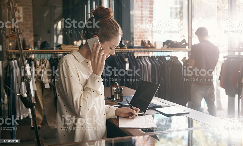 Multitasking is the secret to her success stock photo