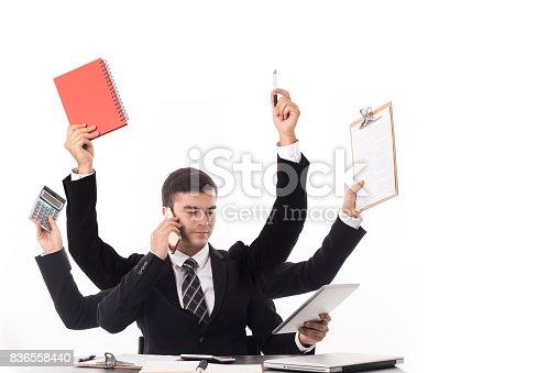 istock Multitasking man busy business manager task 836558440