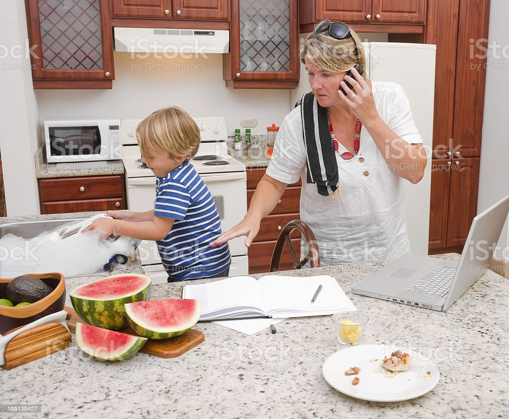 Multi-tasking mother at home royalty-free stock photo