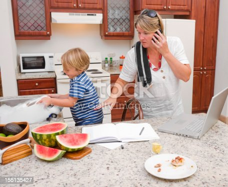 istock Multi-tasking mother at home 155135427