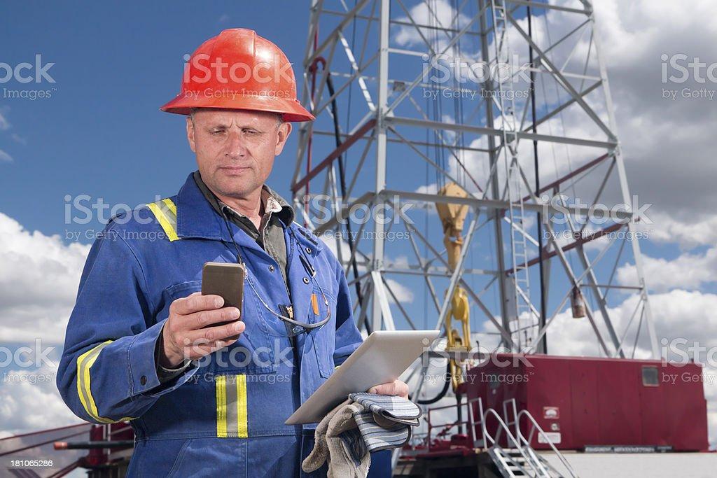 Multitasking Oil Worker stock photo