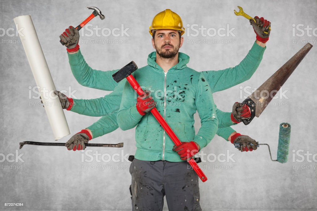 Multitasking specialist with a large number of hands and tools stock photo