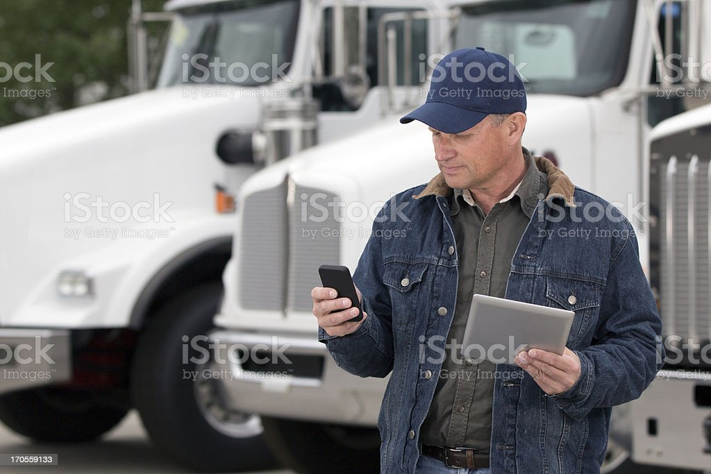 Multitasking Truck Driver stock photo
