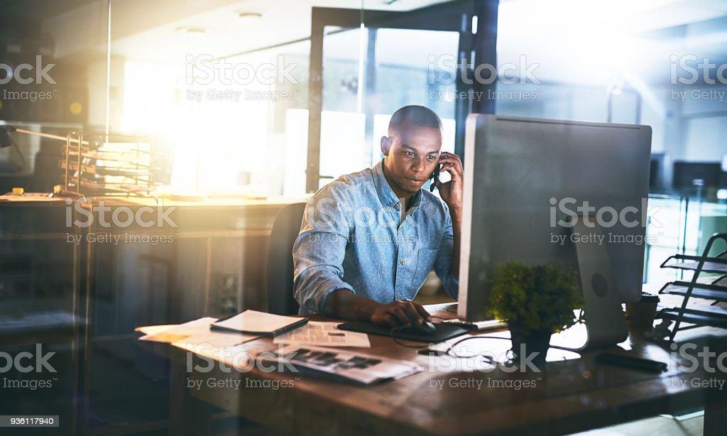 Multitasking will help him reach that deadline stock photo
