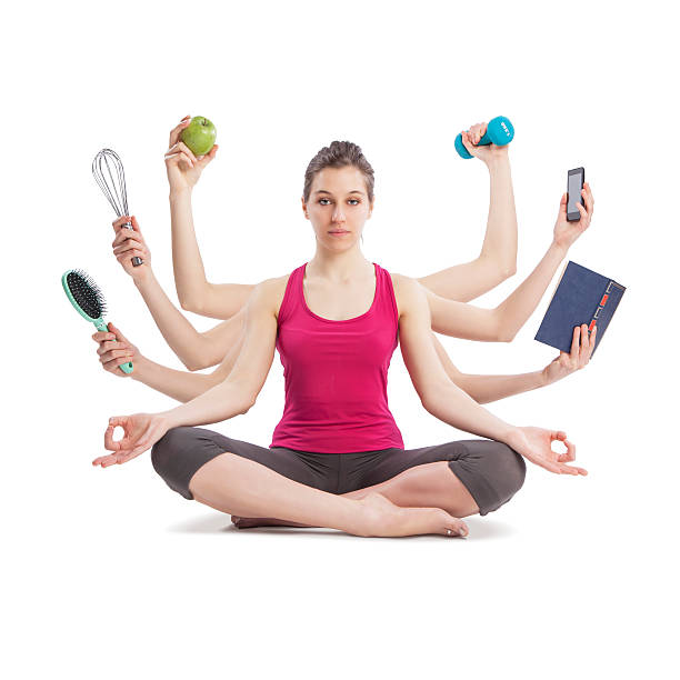 multitasking woman portrait in yoga position with many arms stock photo