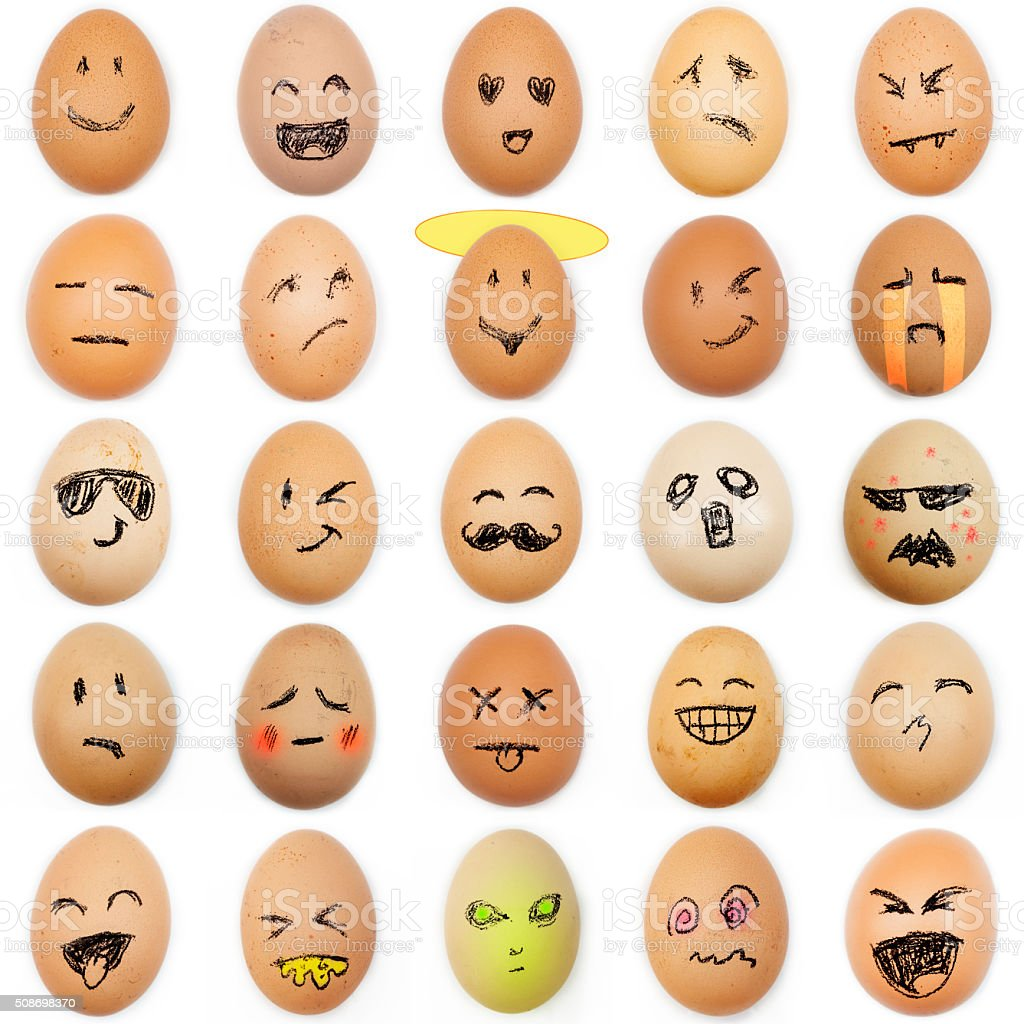 multitude of different smiley faces drawn on the eggshell stock photo