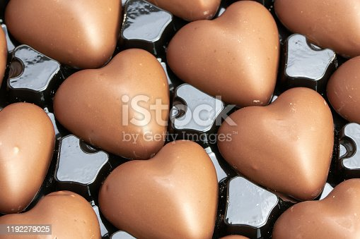 183269671 istock photo Multitude of heart-shaped milk chocolate in their box 1192279025