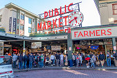 Seattle, Washington, USA / March 2019: A multitude of people at the entrance of the Public Market on Pike Place in Seattle.