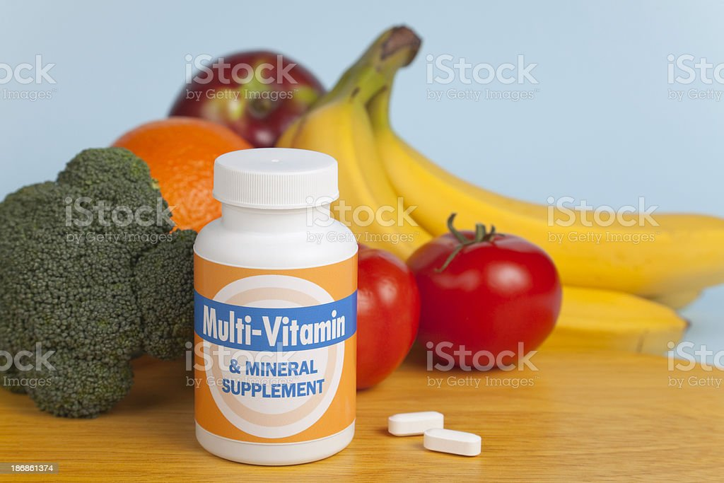 Multi-Vitamins with Fruit and Veggies royalty-free stock photo