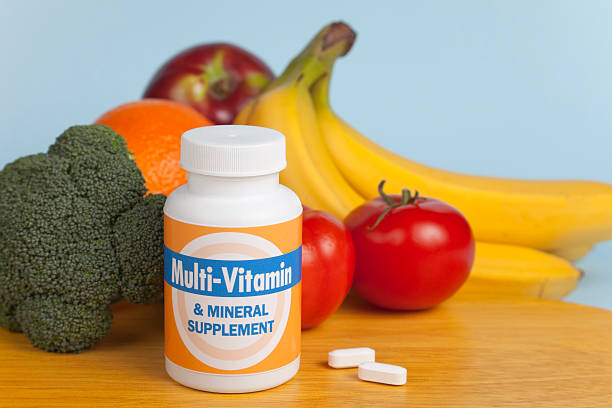 Multi-Vitamins with Fruit and Veggies stock photo