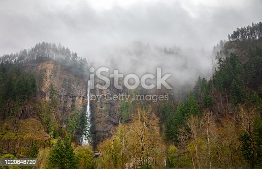 Multnomah Falls with low clouds. Columbia River Gorge, Oregon.