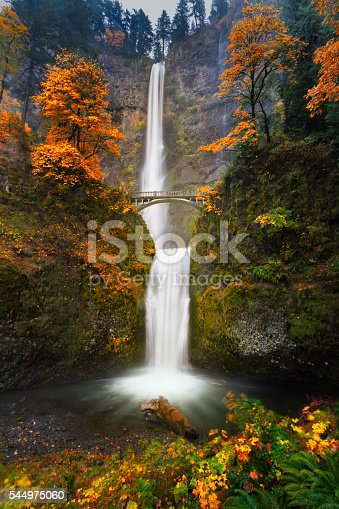 This is a slow shutter shot of Multnomah Falls in Autumn colors.