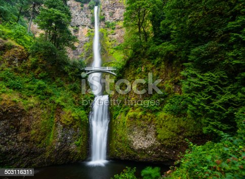 Beautiful Multnomah falls in Columbia River Gorge, Oregon, USA on a fine spring morning