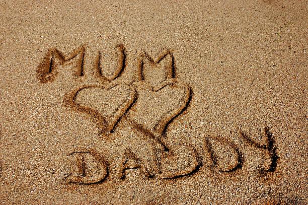 Mum & Daddy on sand... stock photo