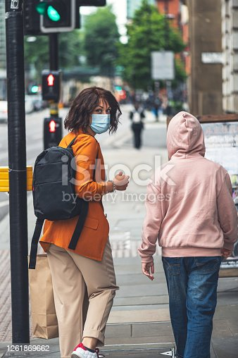 Mum and daughter in face mask are shopping in city centre of MANCHESTER, ENGLAND, UK , new normal