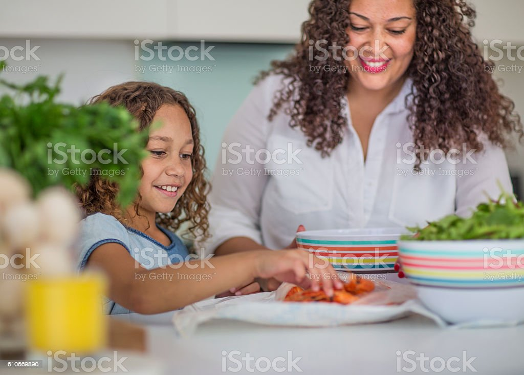 Mum and daughter in the kitchen stock photo
