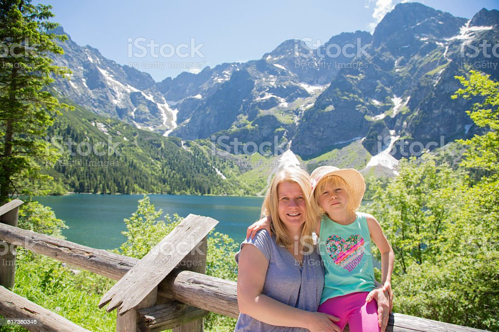 Mum and daughter in the tatra mountains. stock photo