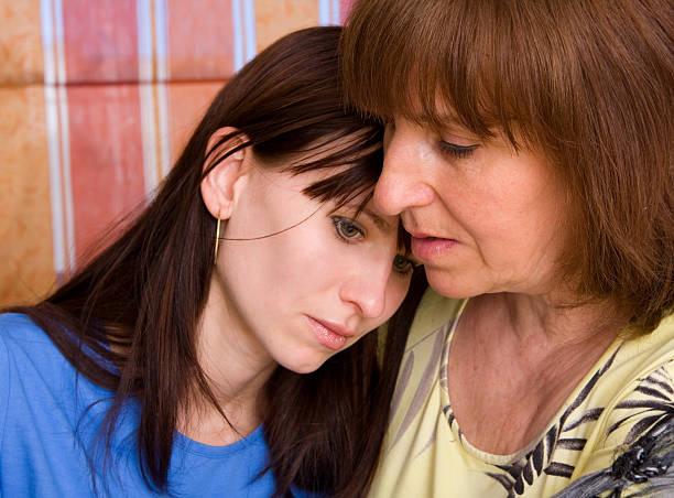 Mum calms the daughter stock photo