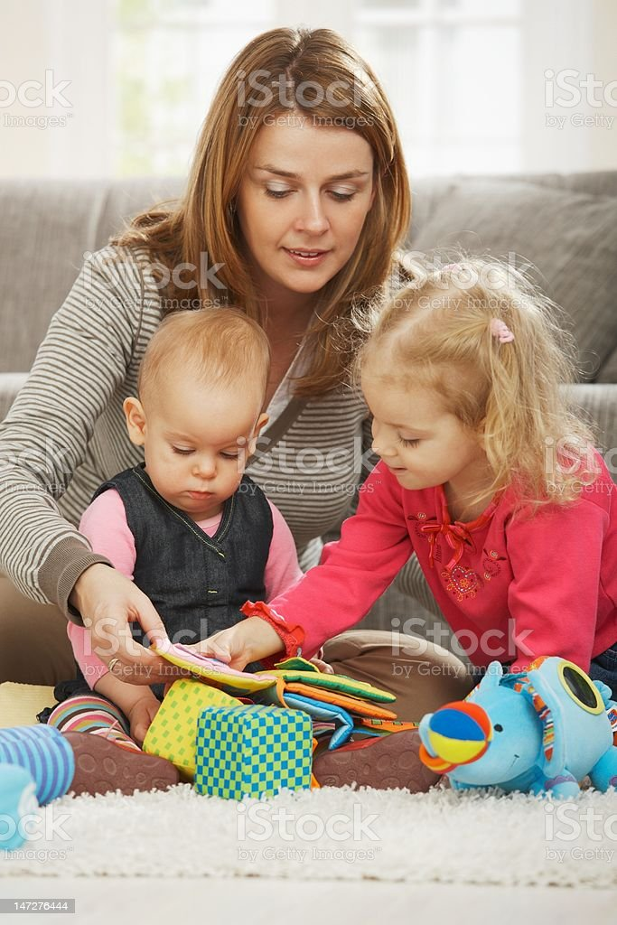 Mum playing with two children stock photo