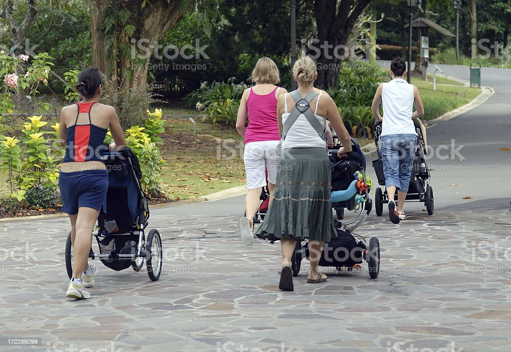 Mum with strollers in the park (Landscape) royalty-free stock photo
