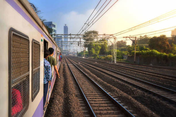 Mumbai, India, Due to overcrowding, people travel in open doors. Mumbai Suburban Railway known as Super-Dense Crush Load and most severe overcrowding in the world stock photo