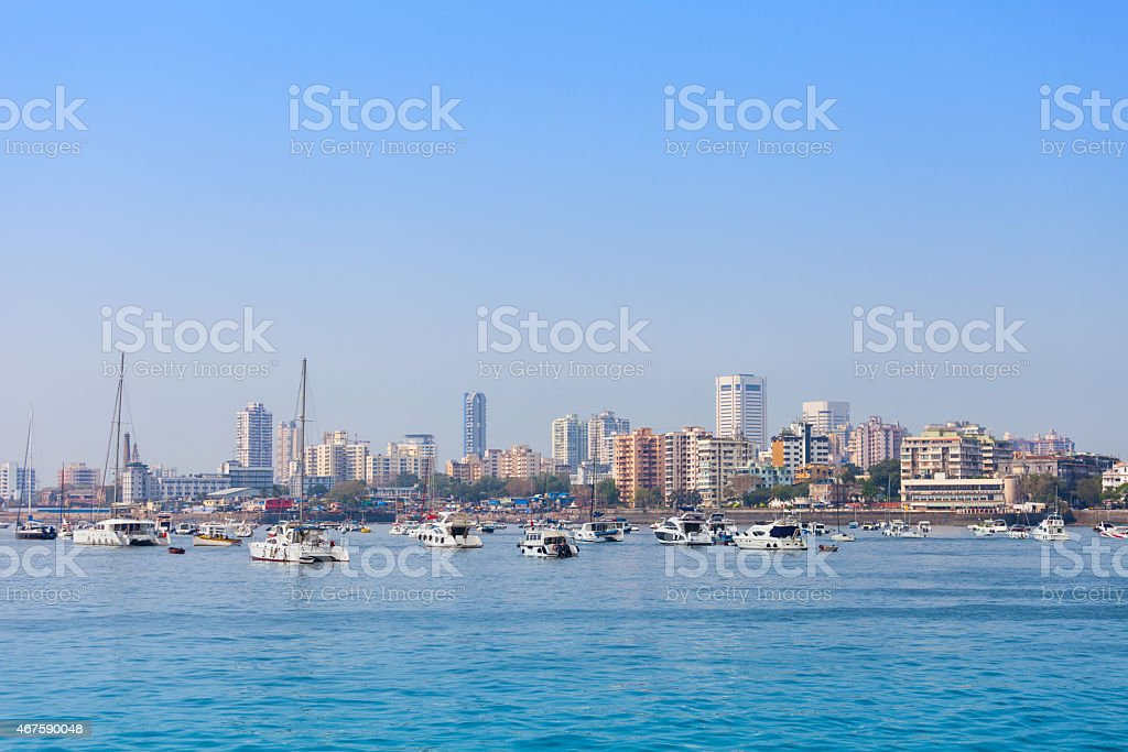 Mumbai skyline on blue day with boats  stock photo