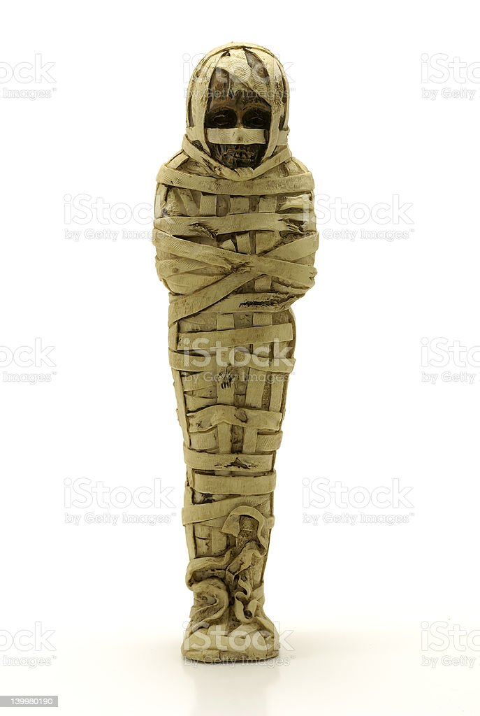 Mummified person wrapped in dirty, beige bandages royalty-free stock photo