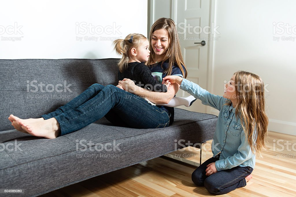 mummy and her kid on sofa stock photo