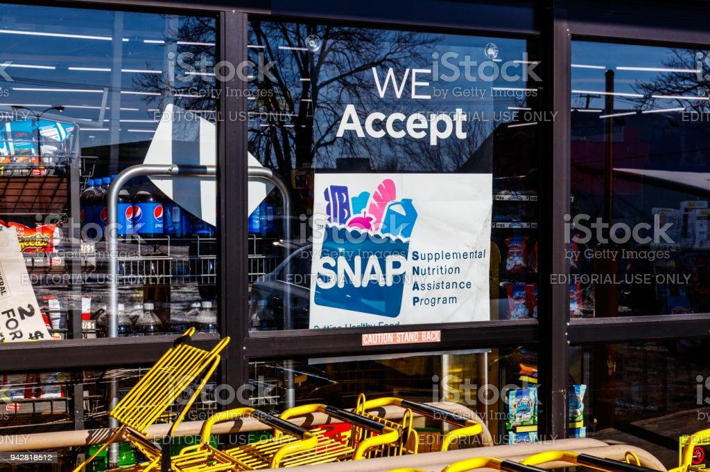 Muncie - Circa January 2018: A Sign at a Retailer - We Accept SNAP stock photo
