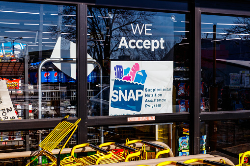Muncie Circa January 2018 A Sign At A Retailer We Accept Snap Stock Photo - Download Image Now