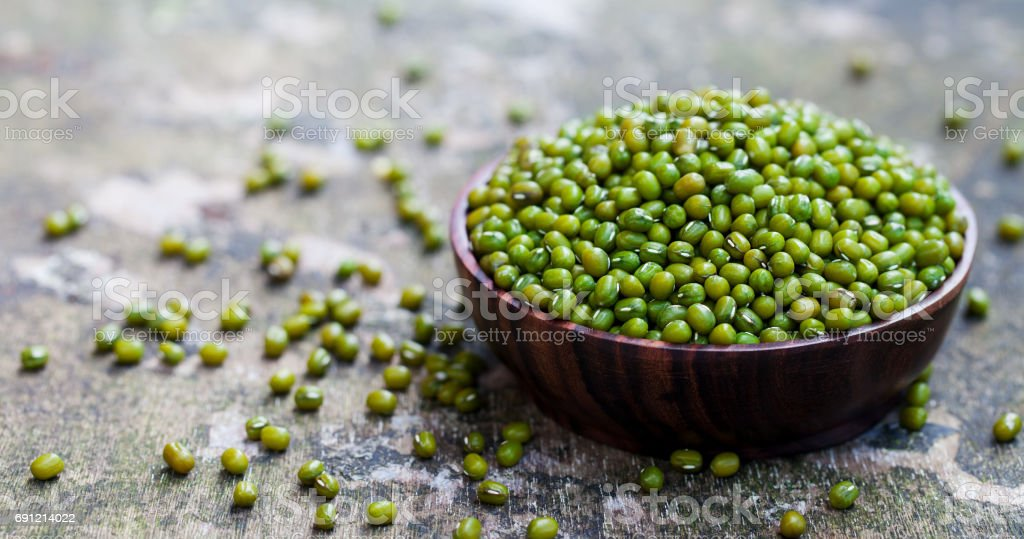 Mung bean, green moong dal in bowl. Copy space. stock photo